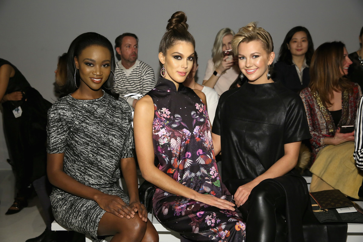 Miss USA 2016, Deshauna Barber, Miss Universe 2016, Iris Mittenaere, and Miss Teen USA 2016, Karlie Hay at New York Fashion Week. Photo: Getty Images