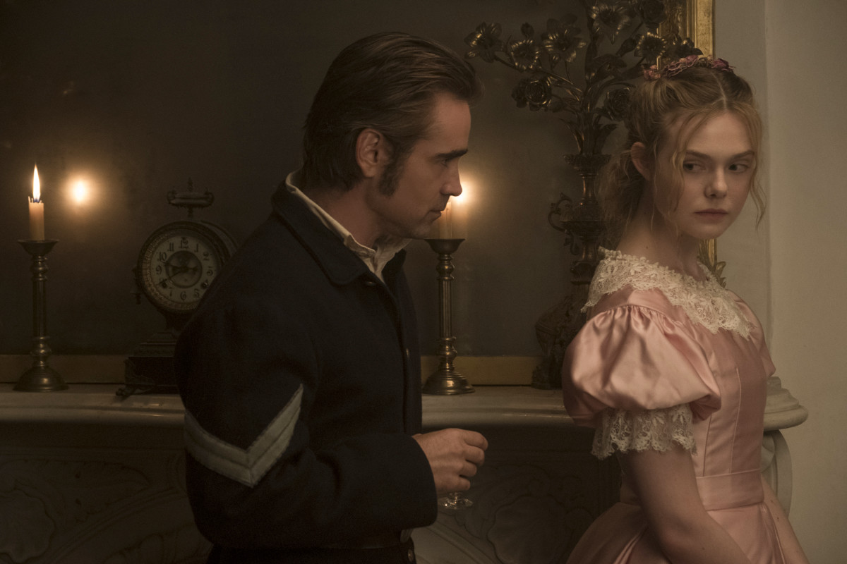 John (Colin Farrell) makes inappropriate eye contact with Alicia (Fanning). Photo: Ben Rothstein / Focus Features