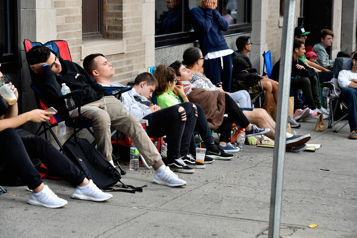 "Hundreds line up, many as early as 4:30 p.m. the day prior, to attend the opening of the Kanye West ""Pablo"" pop-up in Boston. Photo: Paul Marotta/Getty Images"