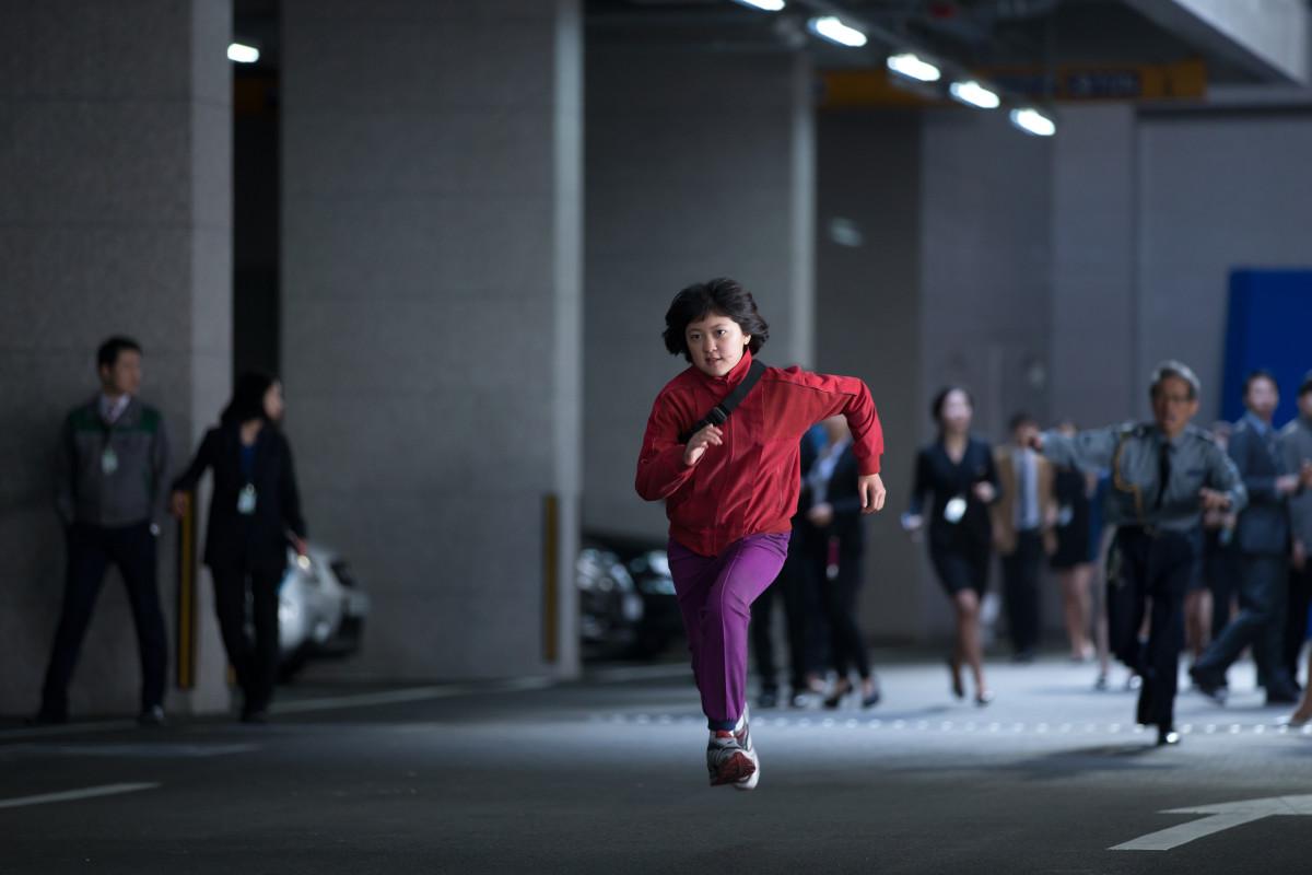 Mija (Ahn) taking names. Photo: Jae Hyuk Lee/Netflix