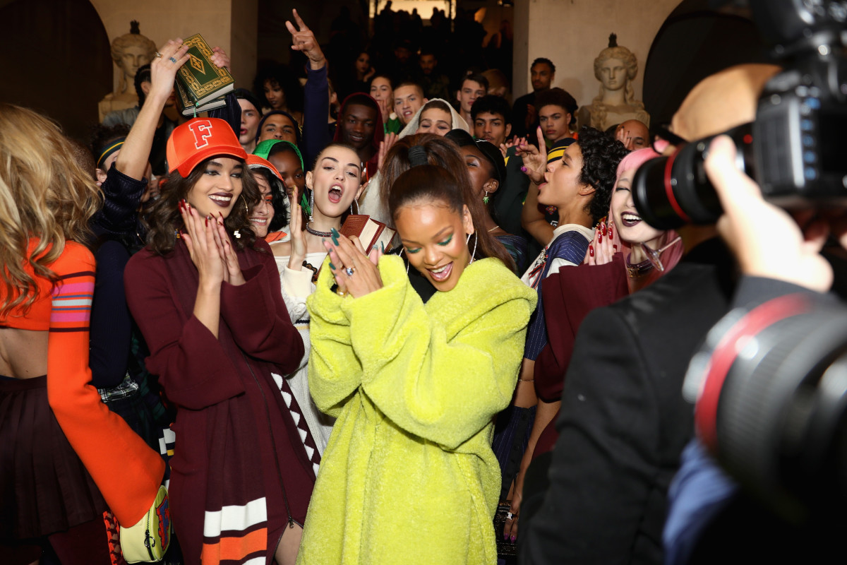 Rihanna with models backstage before Fenty Puma's Fall 2017 runway show at Paris Fashion Week. Photo: Vittorio Zunino Celotto/Getty Images for Fenty Puma