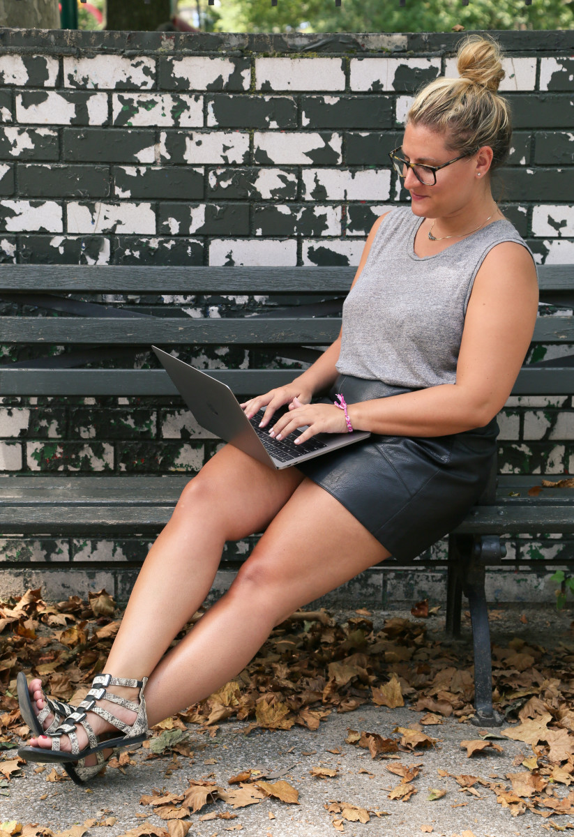 Jill makes full use of her laptop – that's what benches are for.