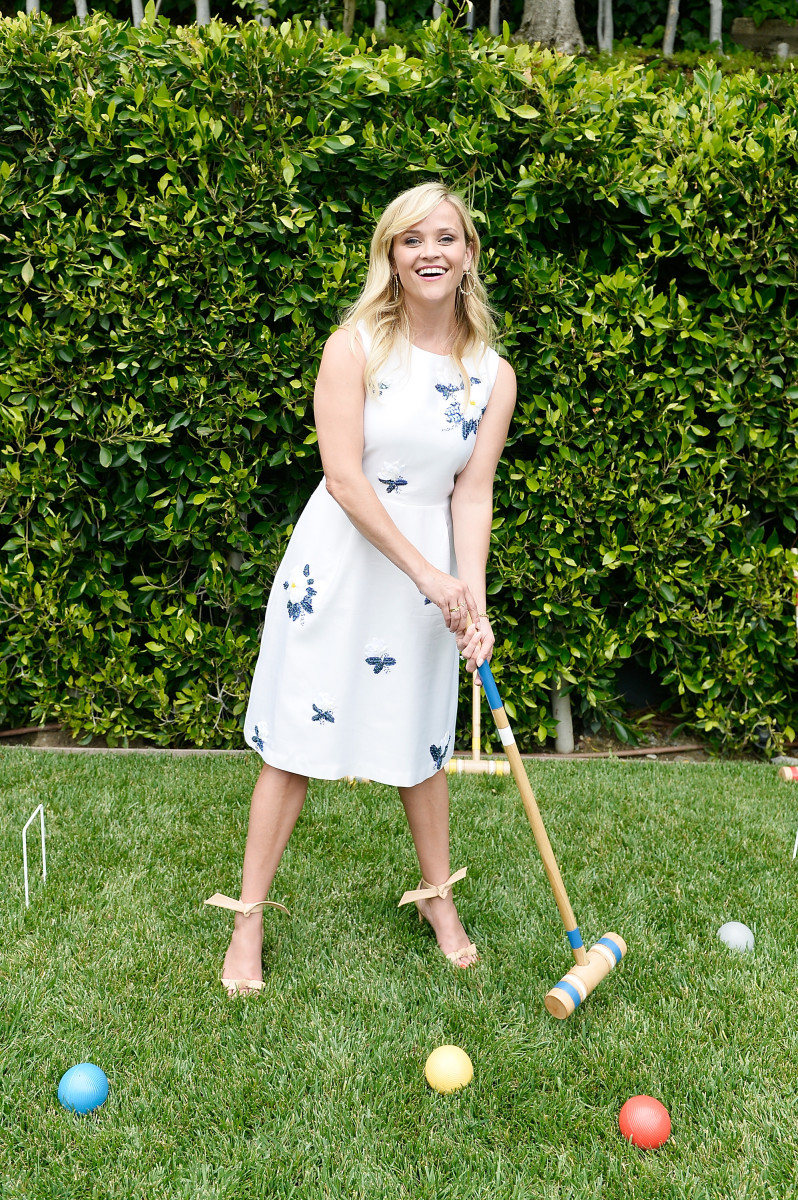 "Reese Witherspoon ""playing croquet"" at a lunch to celebrate Draper James's collaboration with Net-a-Porter. Photo: Stefanie Keenan/Getty Images"