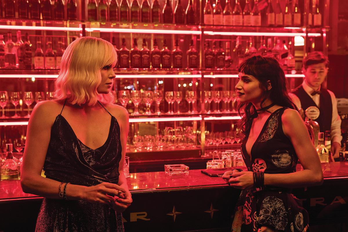 """""""The bronze jumpsuit was a fluke, I found it online and can't recall the designer."""" Damn. Lorraine with Delphine (Sofia Boutella) Photo: Jonathan Prime/Focus Features"""