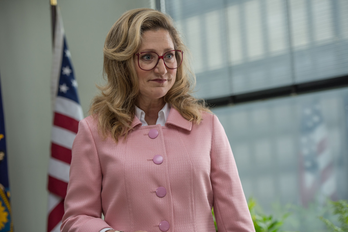 Pat (Edie Falco) in her HRC-inspired pink suit. Photo: Amazon Studios