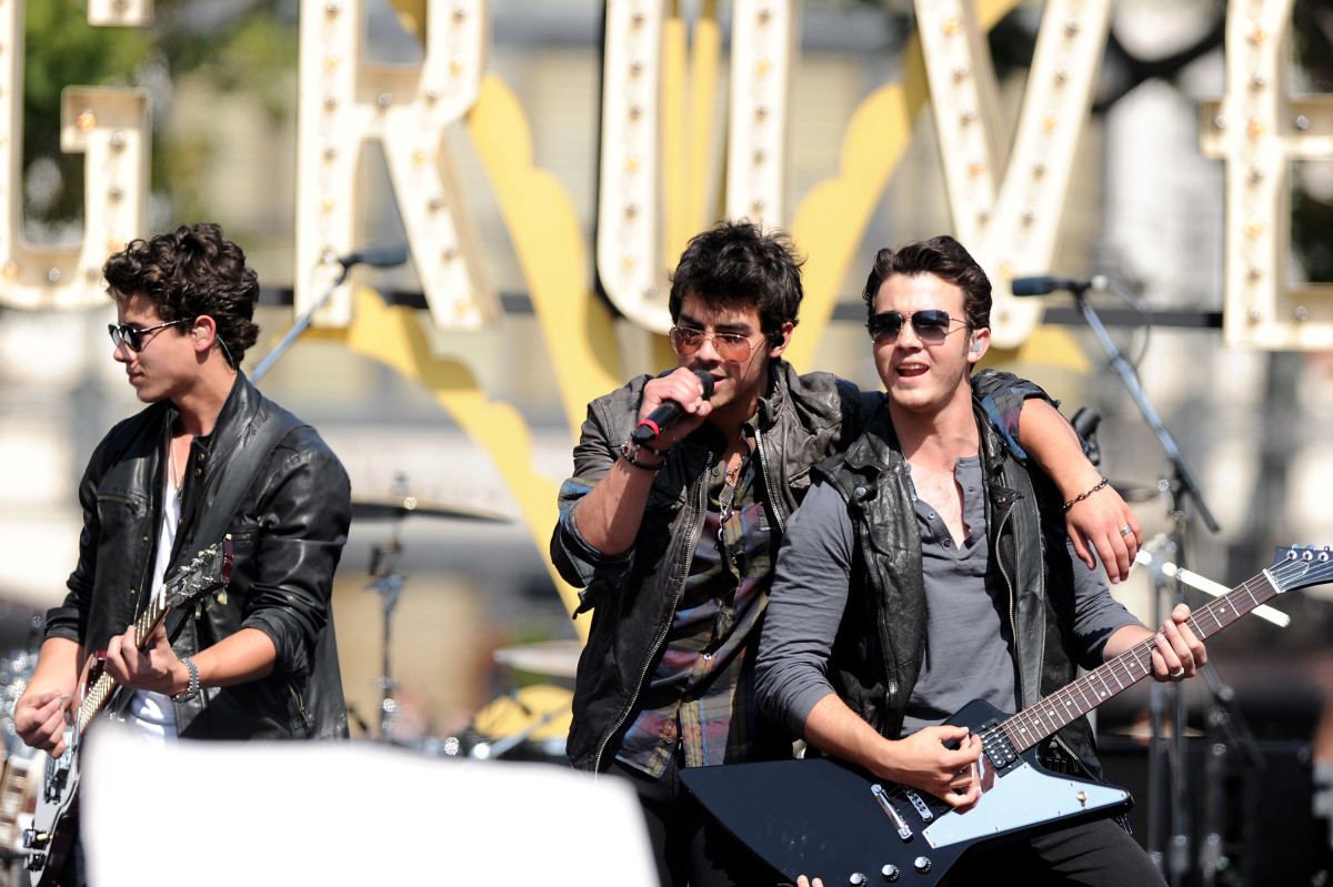 The Jonas Brothers (Nick, Joe and Kevin Jonas) perform at the Grove in May 2010 in Los Angeles. Photo: Alberto E. Rodriguez/Getty Images