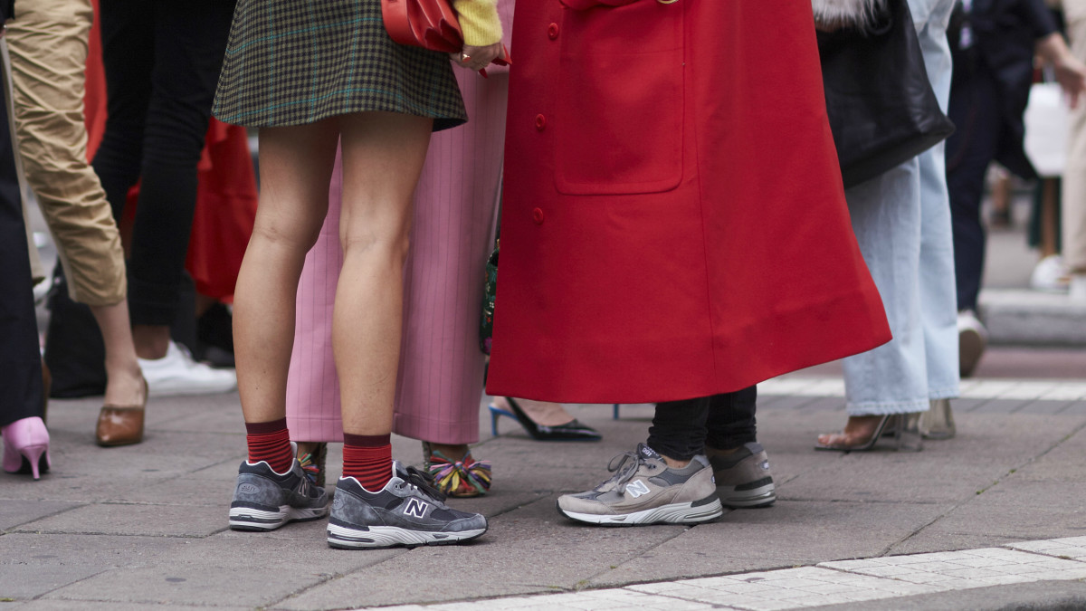 best sneakers 7cbbe b45a4 New Balance sneakers in gray at Stockholm Fashion Week. Photo  Imaxtree