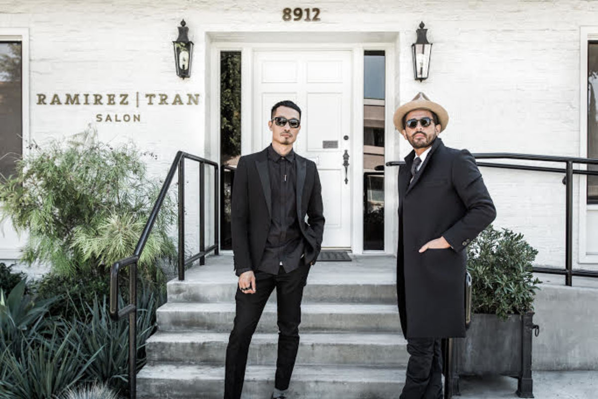 Tran with his business partner, colorist Johnny Ramirez, outside of their namesake Beverly Hills salon. Photo: Courtesy of Anh Co Tran
