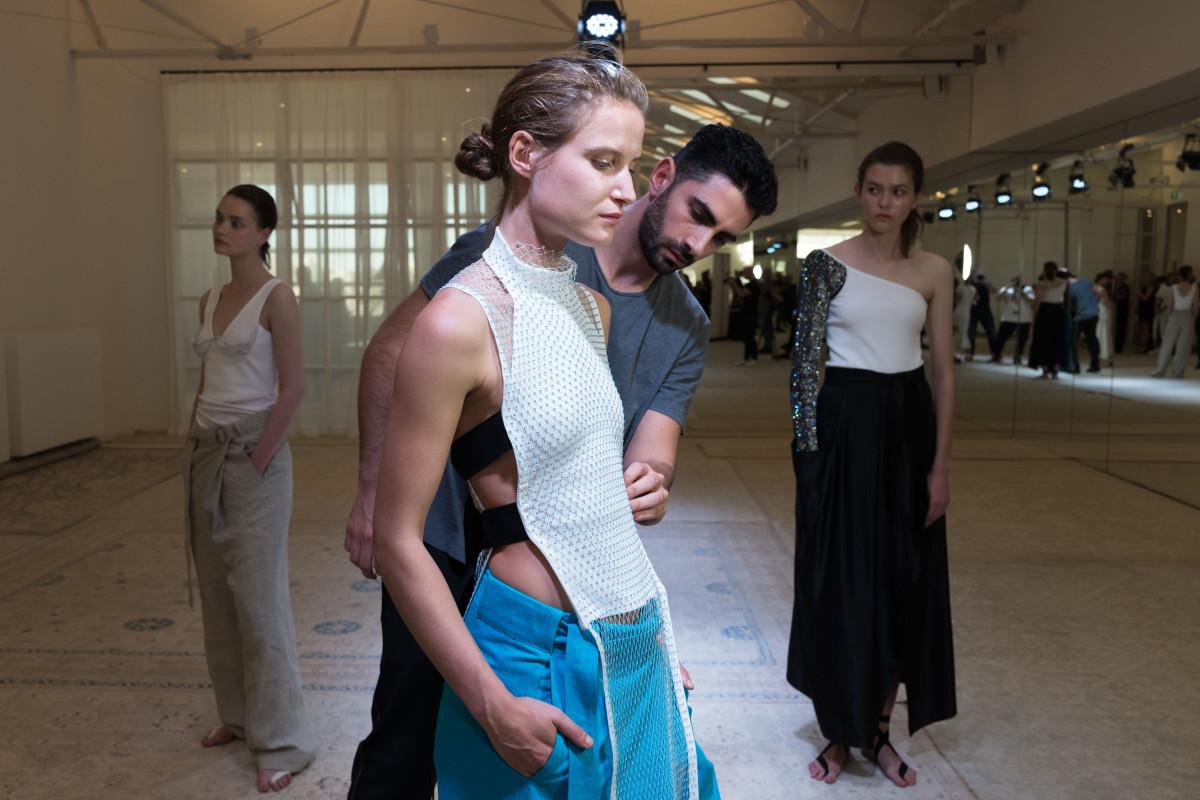 Christopher Esber prepares a model at his Resort 2017 presentation in Sydney. Photo: Courtesy