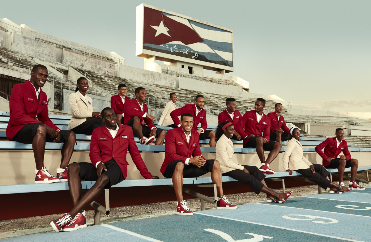 Cuban Athletics Team Members at Estadio Panamericano beneath Cuban National flag in Havana, Cuba. Photo: Rene Habermacher