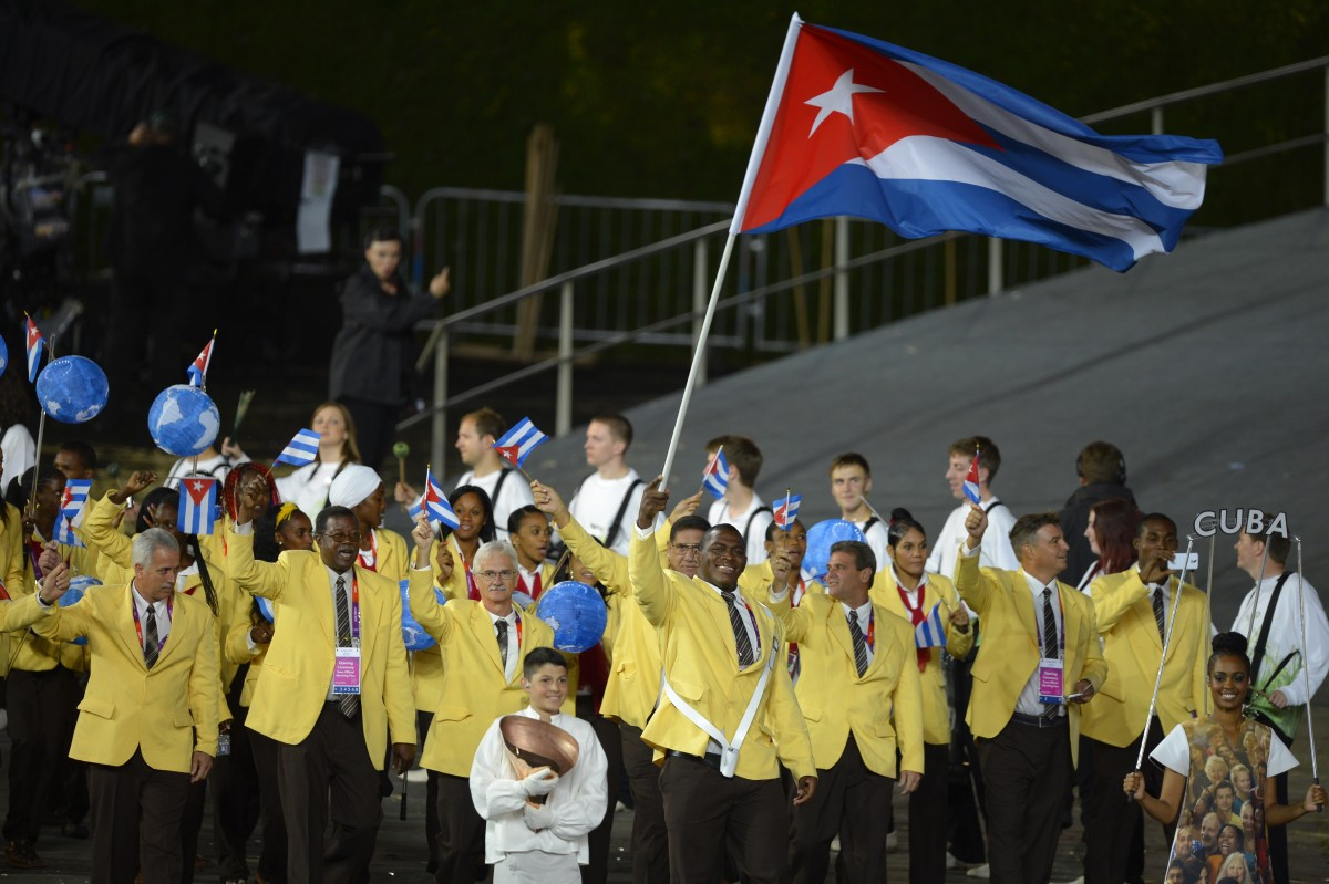 Cuba's flagbearer Mijain Lopez Nunez leads the Cuban delegation  during the opening ceremony of the London 2012 Olympic Games Photo: Odd Andersen/AFP/Getty Images