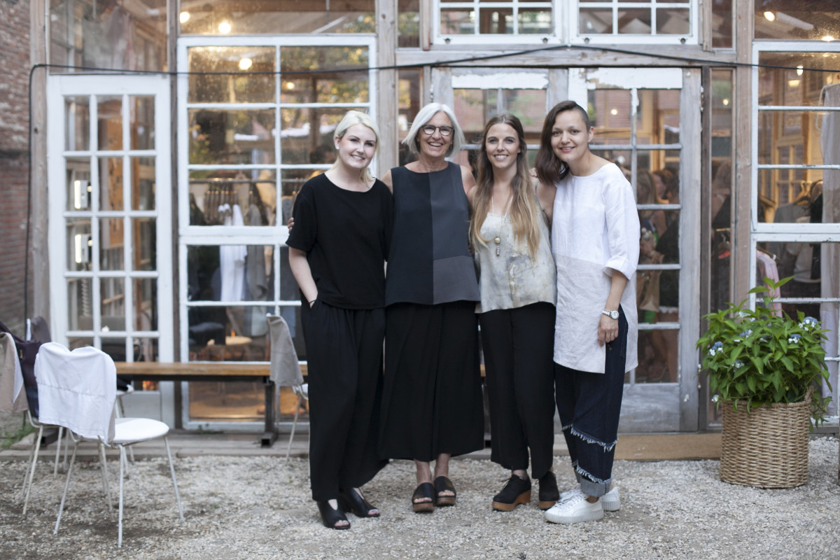 Lucy Jones, Eileen Fisher, Teslin Doud, and Carmen Gama stand together outside the Eileen Fisher Remade Pop-up store. Shop the Eileen Fisher Remade Pop-up in Brooklyn at 47 Bergen St. on July 23, 24, 29 and 30th!