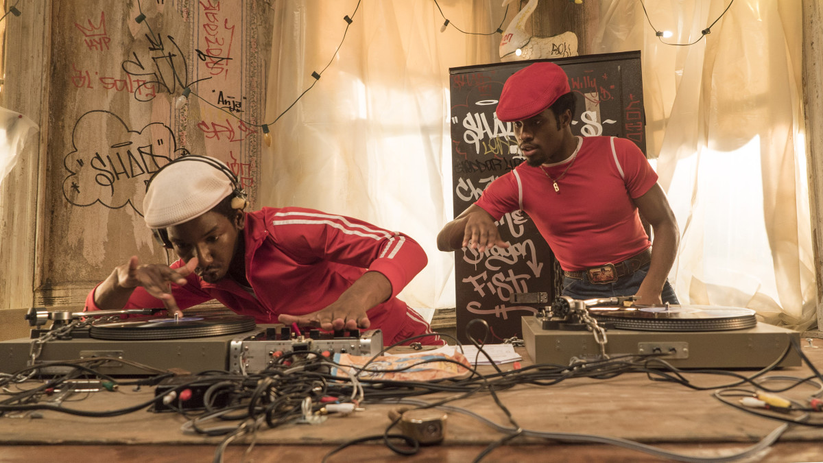 Shaolin Fantastic (right) learns to scratch from the master, Grandmaster Flash. Photo: Netflix