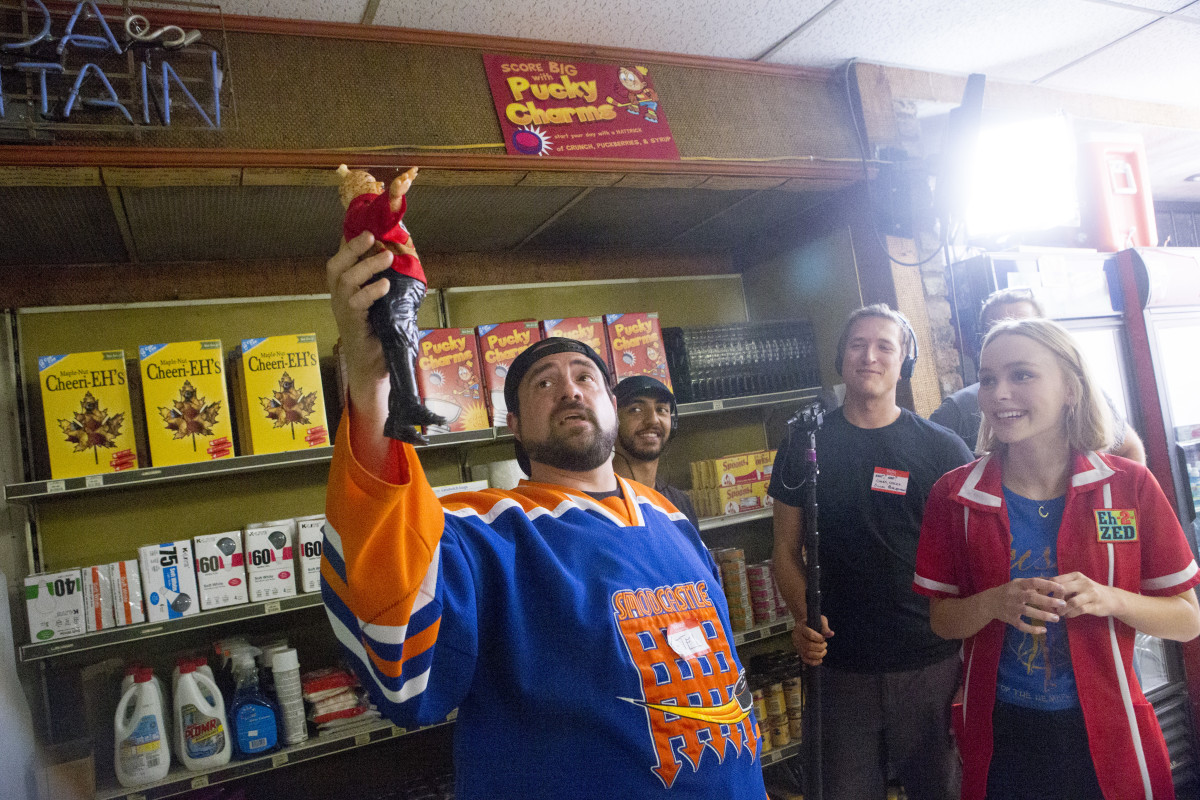 Kevin Smith holds up a RCMP dressed Bratzi as Depp looks on. Photo: Yoga Hosers