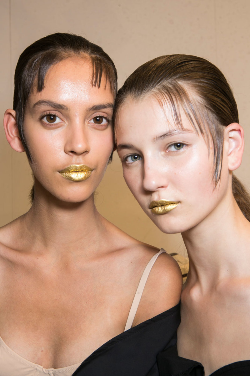 Can you pull off metallic gold lips like the models at Prada's spring 2016 show? Photo: Imaxtree