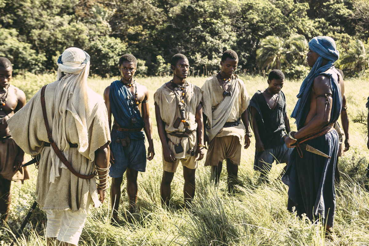 """The costumes needed to be harmonious, and interesting by their color relationships and beauty,"" says Carter. Kunta Kinte (Malachi Kirby, center) in a scene from ""Night One."" Photo: History Channel/Roots"