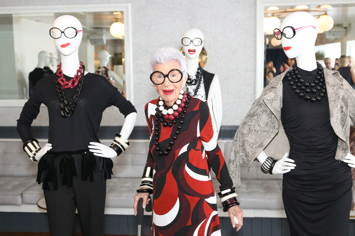 Iris Apfel poses with mannequins wearing looks from theIris Meets INC collection. Photo: BFA