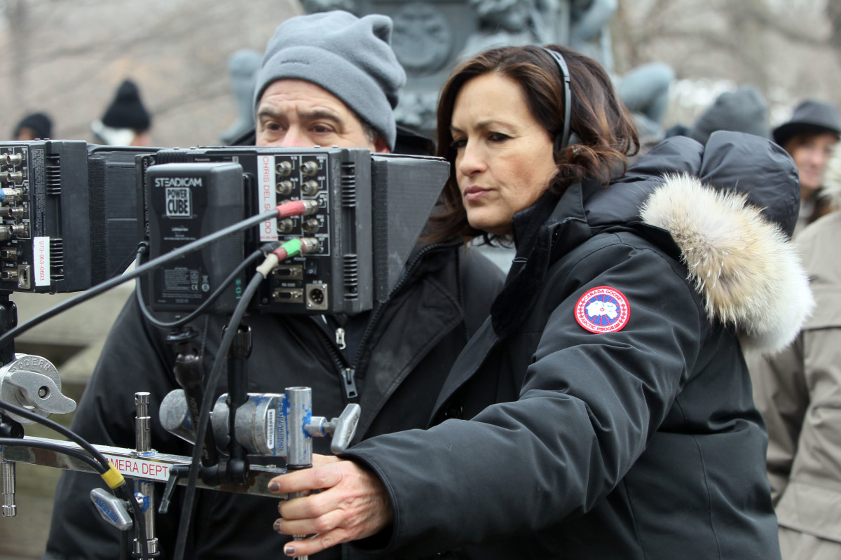 Det. Benson, er, Mariska Hargitay stays warm in her Canada Goose parka while behind the camera. Photo: Canada Goose