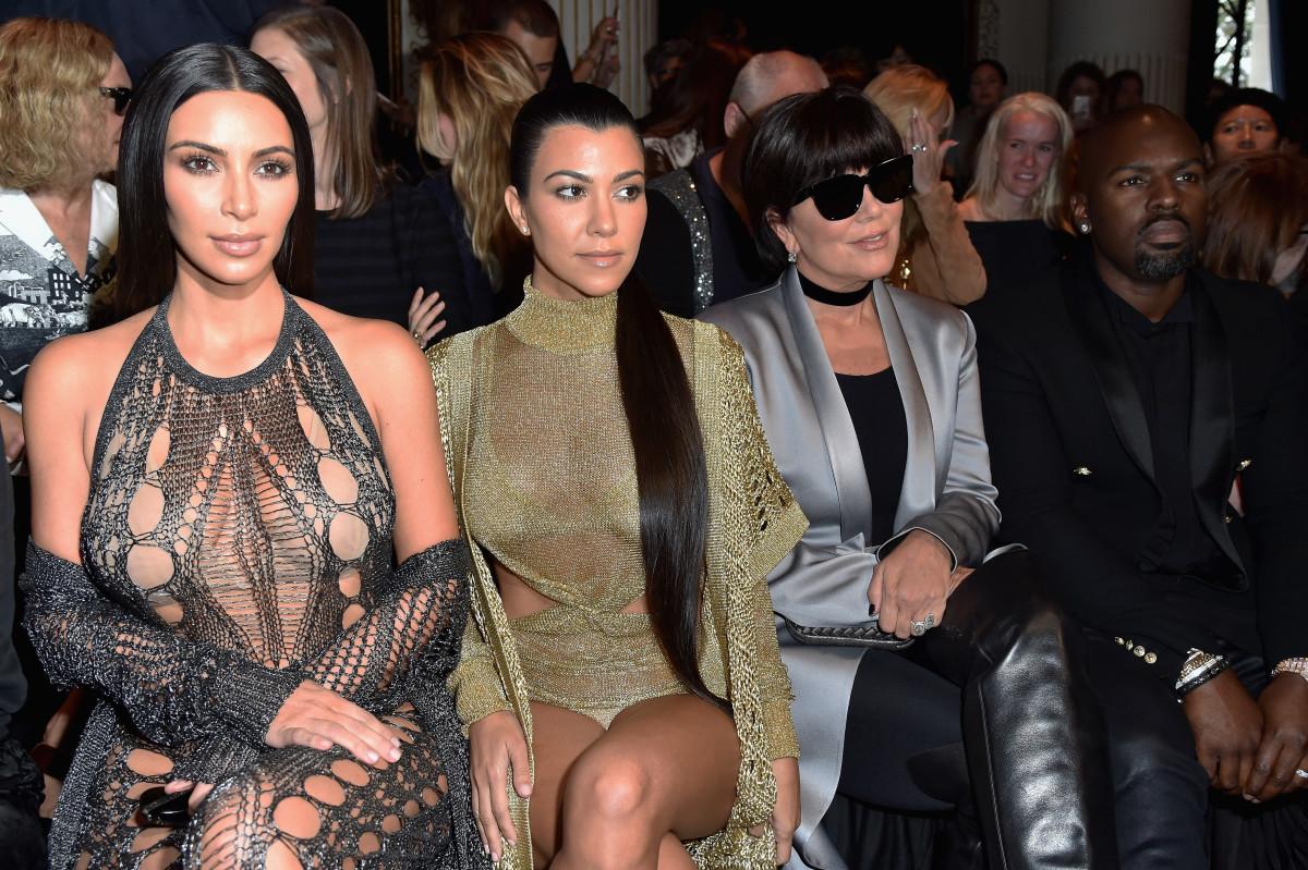Kim Kardashian, Kourtney Kardashian, Kris Jenner and Corey Gamble at the Balmain spring 2017 show during Paris Fashion Week. Photo:Pascal Le Segretain/Getty Images