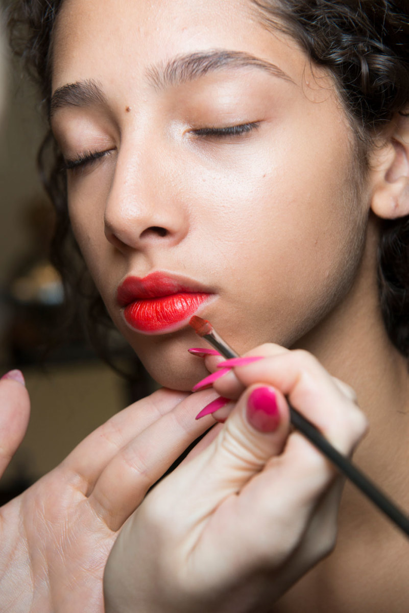 Maybelline's Vivid Matte Liquid lipstick in action backstage at Jason Wu spring 2017. Photo: Imaxtree