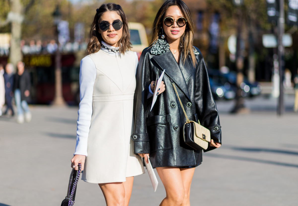 Camila Coelho and Aimee Song on the street during Paris Fashion Week. Photo: Christian Vierig/Getty Images