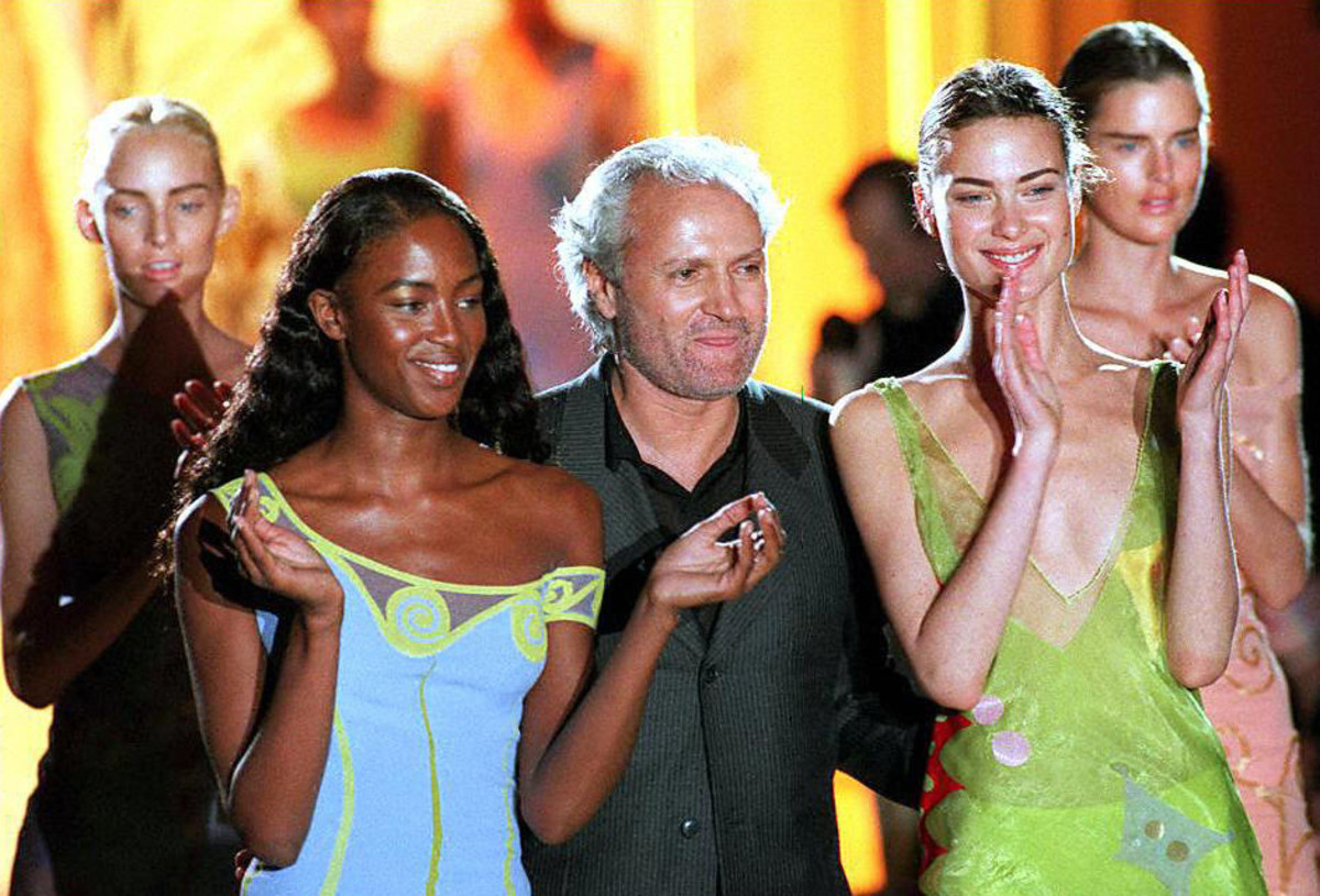 Gianni Versace with Naomi Campbell and Shalom Harlow at his final his haute couture show in Paris. Photo: Pierre Verdy/AFP/Getty Images