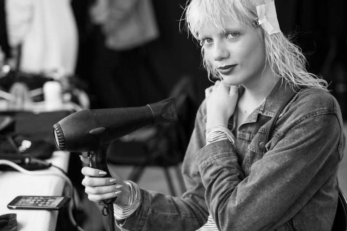 Model Marjan Jonkman with a blowdryer backstage at Kenzo. Photo: Ian Gavan/Getty Images