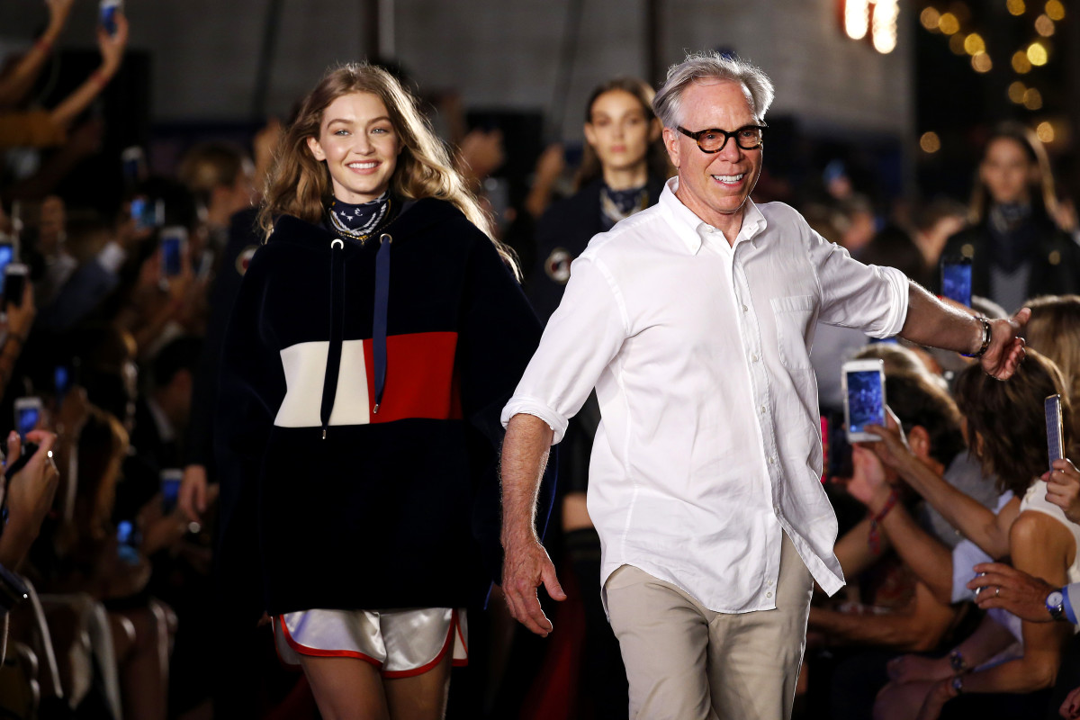 6afb24ff Gigi Hadid and Tommy Hilfiger at the brand's New York Fashion Week runway  show on Sept