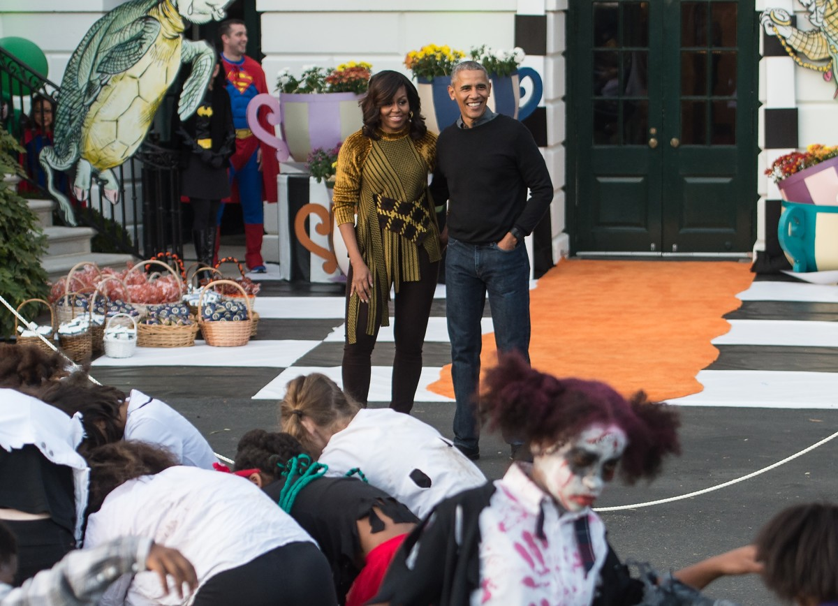 President Barack Obama and First Lady Michelle Obama at the White House Halloween party on Monday. Photo: Nicholas Kamm/AFP/Getty Images