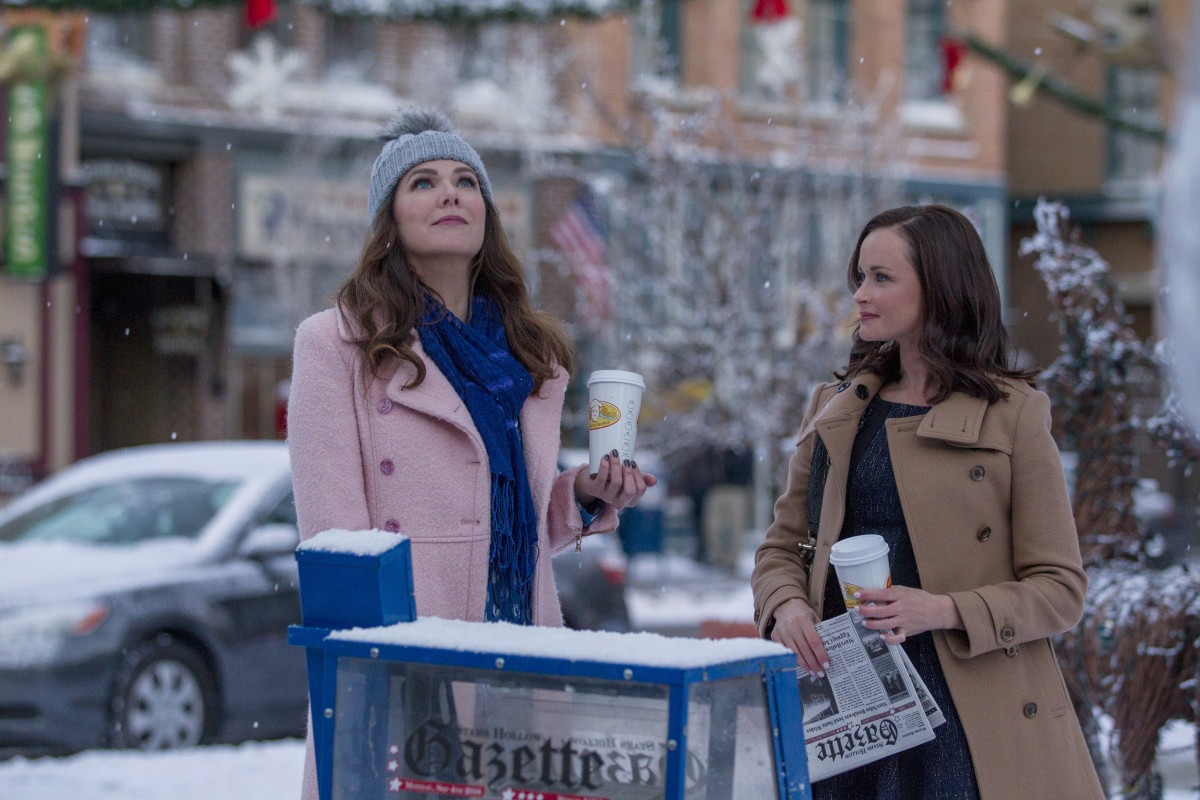 Lorelai (Lauren Graham) smells snow as Rory (Alexis Bledel) looks on. Photo: Saeed Adyani/Netflix
