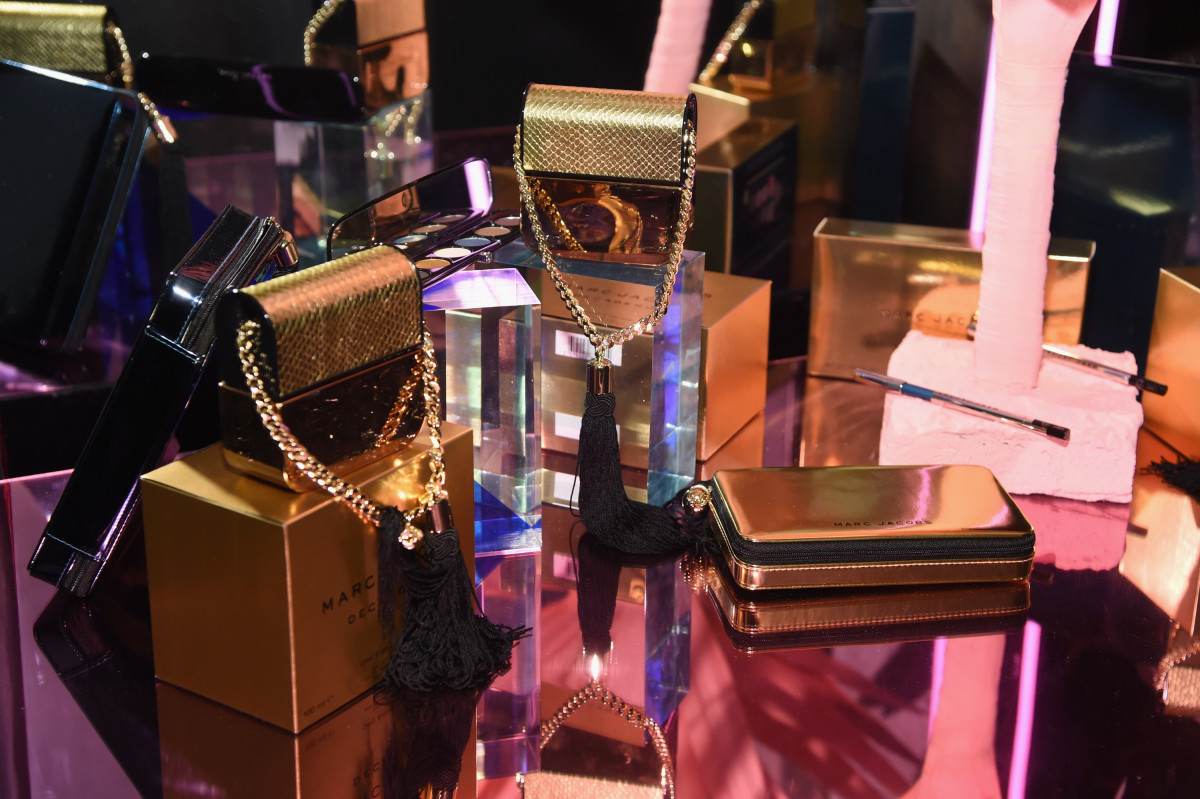 Various Marc Jacobs fragrances, dripping in gold. Photo: Jamie McCarthy/Getty Images for Marc Jacobs