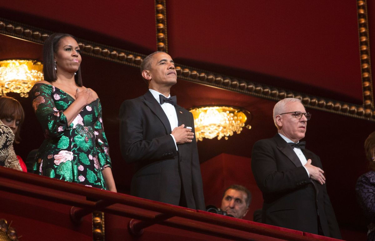 First Lady Michelle Obama and President Barack Obama during the National Anthem. Photo: Chris Kleponis/AFP/Getty Images