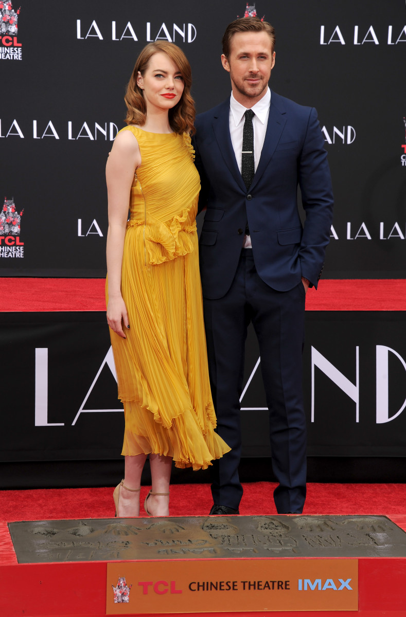 Emma Stone in Rochas and Ryan Gosling in Gucci at their Hand and Footprint Ceremony at the TCL Chinese Theatre on Wednesdayin Hollywood. Photo: Gregg DeGuire/WireImage