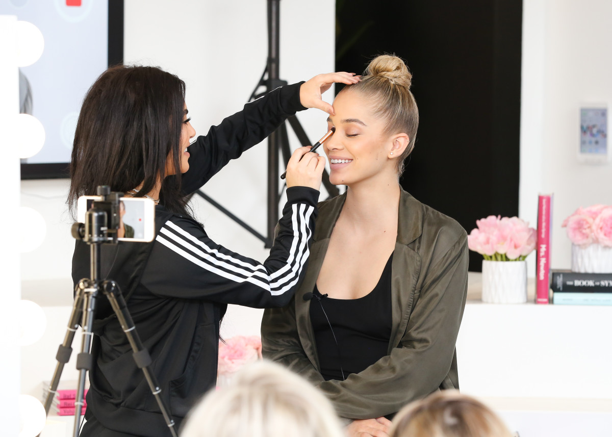 Makeup artist Hrush Achemyan and model Jasmine Sanders doing a live demonstration at the Revolve Beauty launch event. Photo: BFA