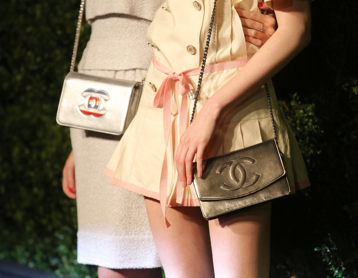 Chanel bags on Harley Viera-Newton and Laura Love. Photo: Jemal Countess/Getty Images