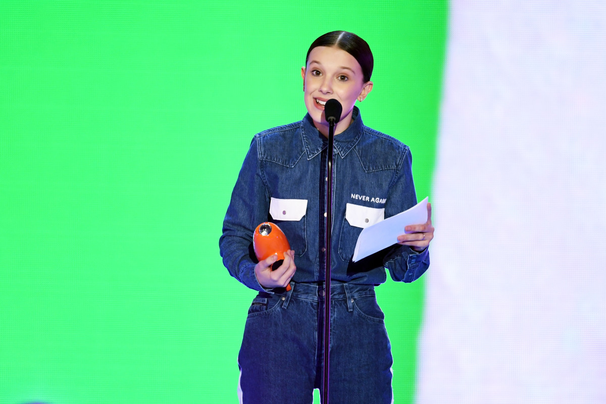 Millie Bobbie Brown accepting her award for Favorite TV actress at the 2018 Kids' Choice Awards in a custom Calvin Klein ensemble. Photo: Kevin Winter/Getty Images
