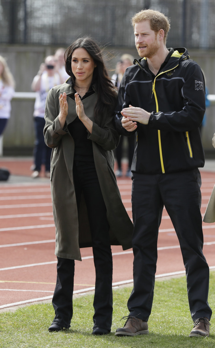 Prince Harry and his fiancee Meghan Markle applaud as they attend the U.K. Team Trials for the Invictus Games Sydney 2018 at the University of Bath Sports Training Village. Photo: Kirsty Wigglesworth /Getty Images