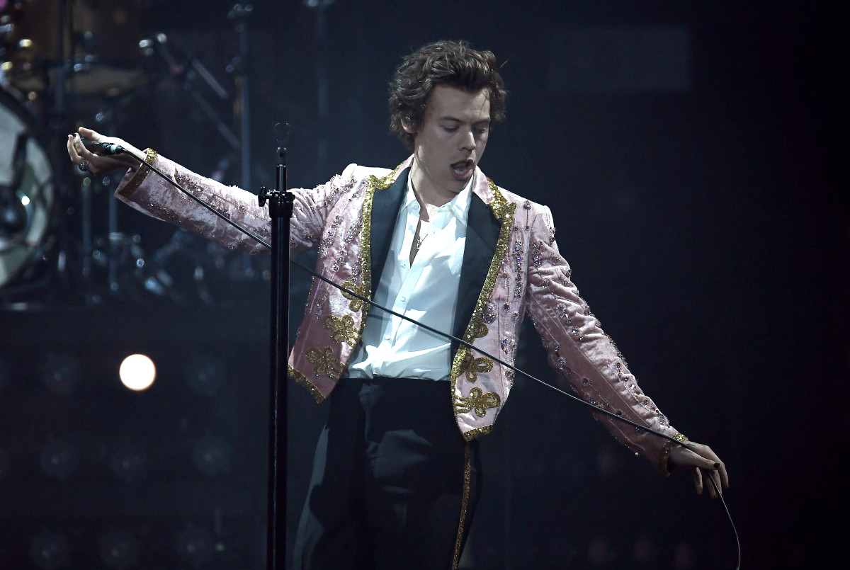 Harry Styles in a custom Gucci suit performing in London on Wednesday. Photo: Gareth Cattermole/Getty Images