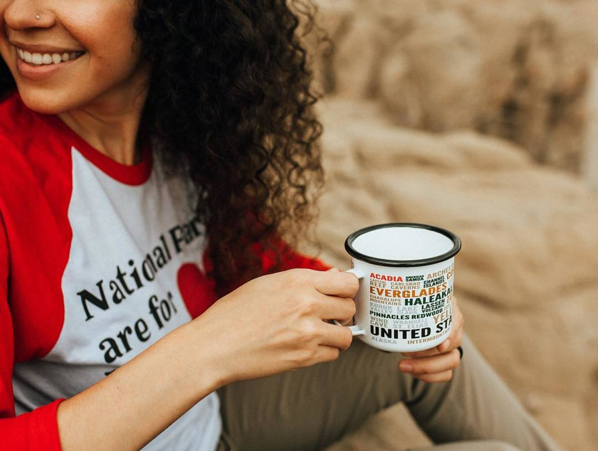 National Parks Are for Lovers Raglan, $40 and All Parks Enamel Mug, $18. Photo: @parksproject/Instagram