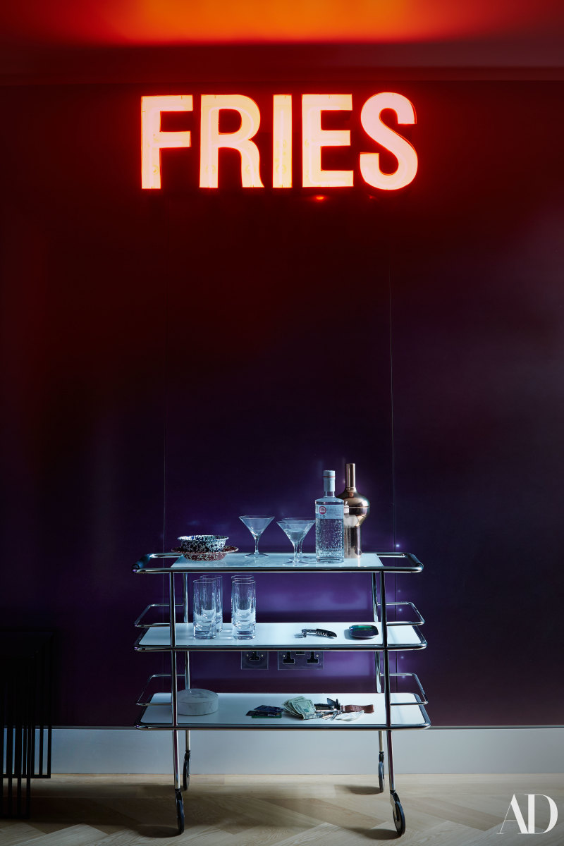 "Cara Delevingne's bar cart with a ""Fries"" sign she'd picked up before moving in. Photo: Skyler Smith/Architectural Digest"