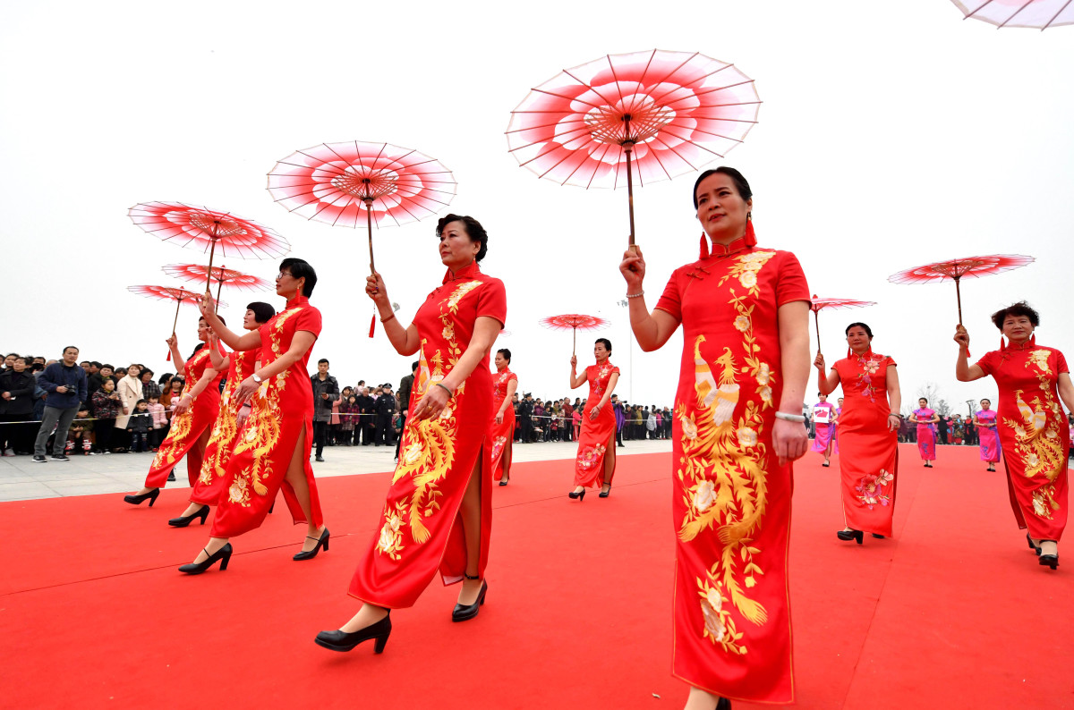 Women in Bozhou, within the Anhui province of China, wearing the traditional Chinese dress known as the qipao. Photo: VCG/VCG via Getty Images