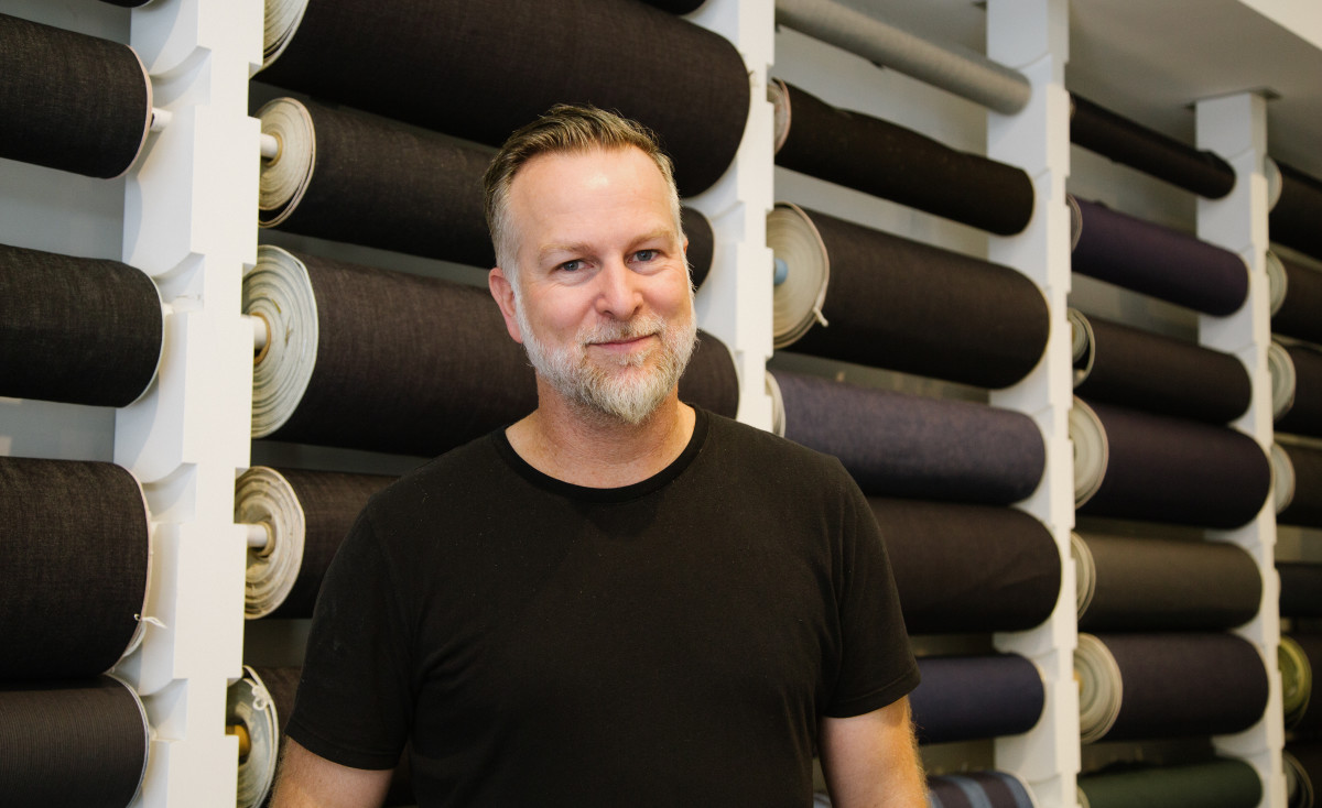 Scott Morrison in front of 3x1's wall of selvedge denim rolls. Photo: Whitney Bauck/Fashionista
