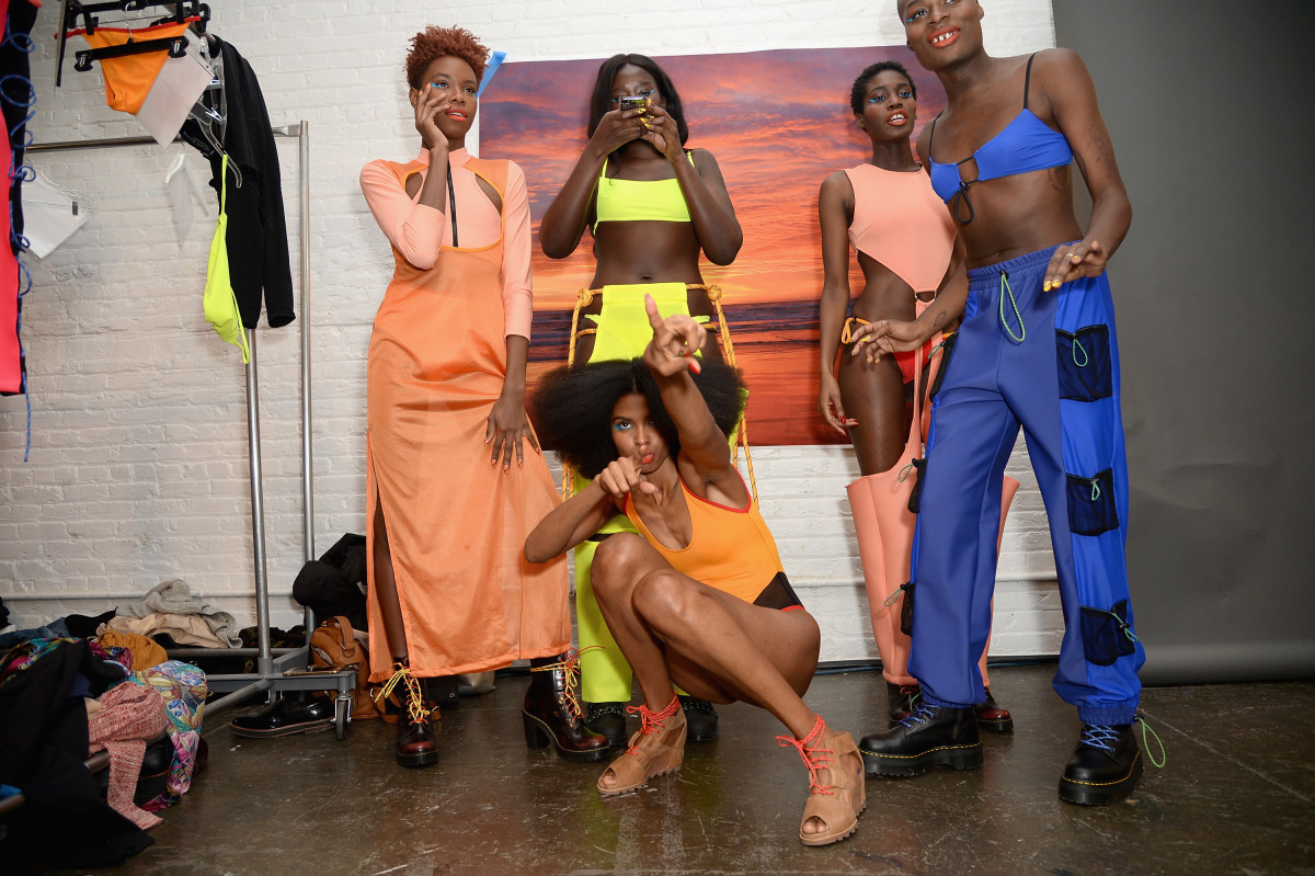 Models backstage at Chromat's Fall 2018 runway show. Photo: Andrew Toth/Getty Images for Chromat
