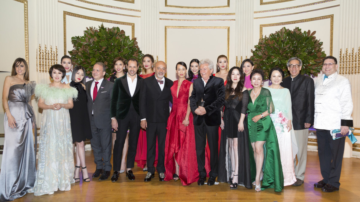 Honorees and VIP guests, including Yue-Sai Kan (second from left), Massimiliano Giornetti (starting fifth from left), Christian Louboutin, Maggie Q, Alessandro Bastagli and Grace Chen. Photo: Courtesy