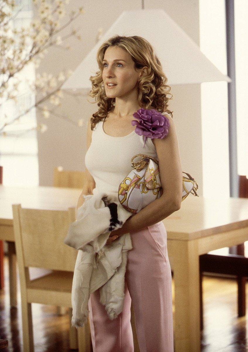 Carrie with her signature flower and Dior saddle bag. Photo: Craig Blankenhorn/HBO