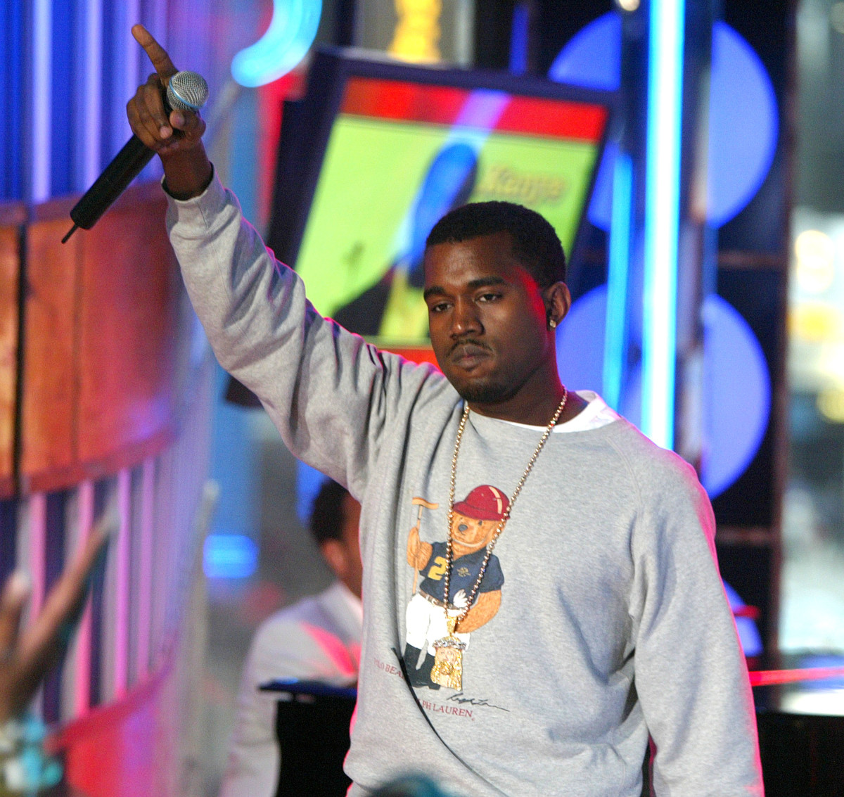 "Rapper Kanye West wears a Polo Bear sweatshirt on stage during MTV's ""Total Request Live"" in 2004. Photo: Scott Gries/Getty Images"