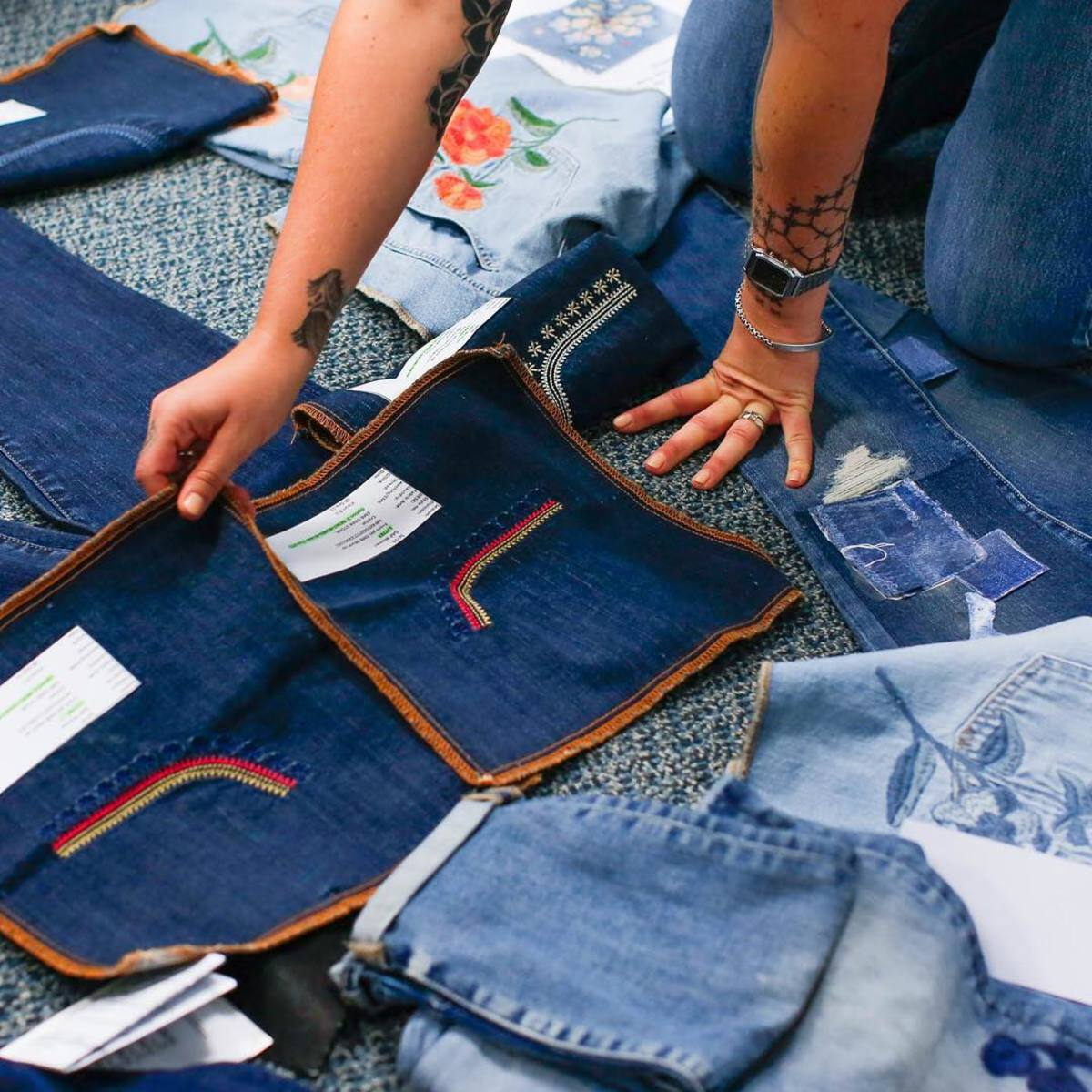The Gap design team examining embroidered denim from its past, present and future collections. Photo: @gapinc/Instagram