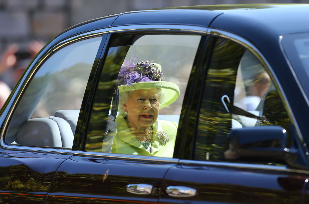 Queen Elizabeth II in an Angela Kelly hat at St George s Chapel at Windsor  Castle before 9162ec32e00b