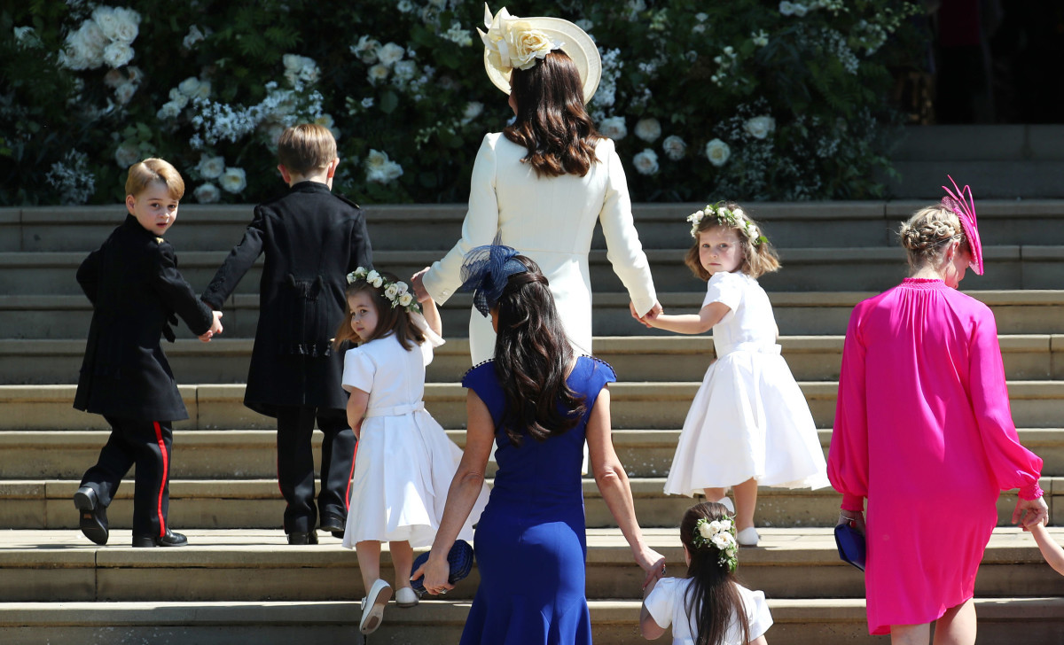 Kate Middleton with Prince George, Princess Charlotte and other children walking up the west steps of Windsor Castle. Photo: Jane Barlow/AFP/Getty Images