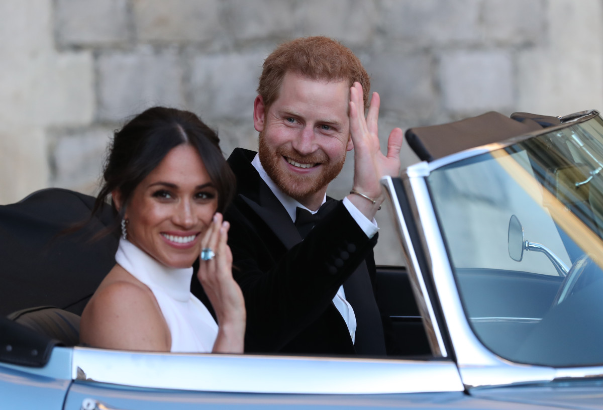 Meghan Markle and Prince Harry depart for their evening wedding reception. Photo: STEVE PARSONS/AFP/Getty Images